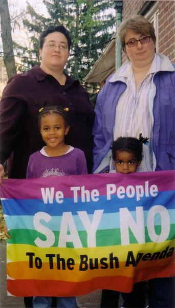 Marla Brettschneider and family with anti-Bush banner