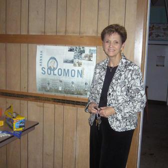 Carol Wise Beside JWA Poster in the Abandonded Congregation Beth Israel in Biloxi