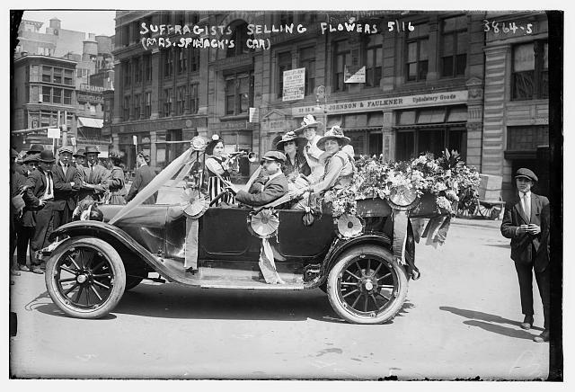 Suffragists selling flowers, 5/16 (Mrs. Spinack's car)