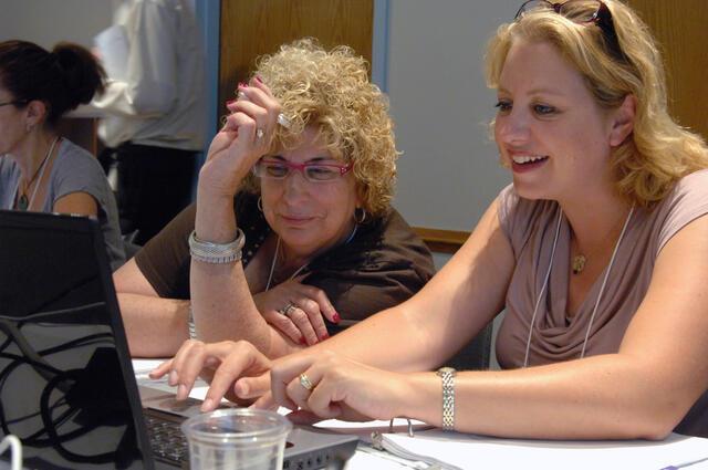 Educators at computer