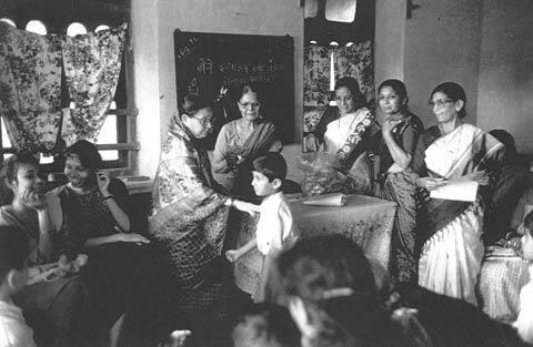 Members of Shri Mandal Distribute Presents in Bombay