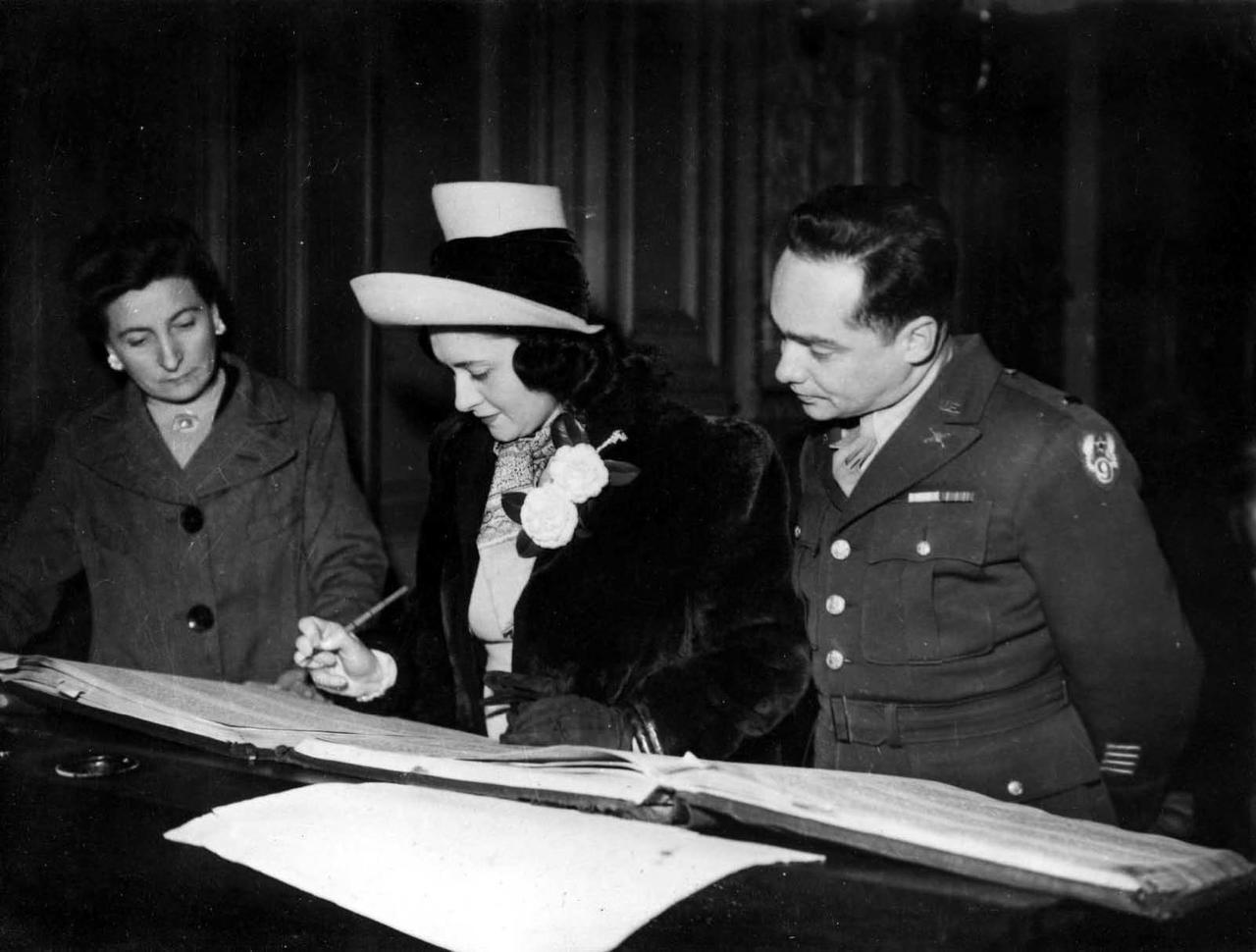 Denise and Stanley Shorr Signing Their Marriage Registry, 1944