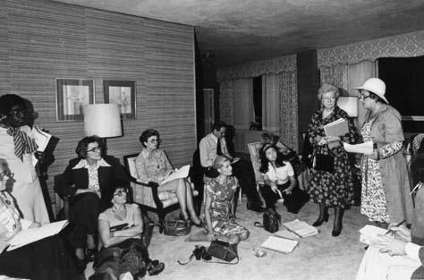 Meeting in a hotel room to discuss strategy during the National Women's Convention