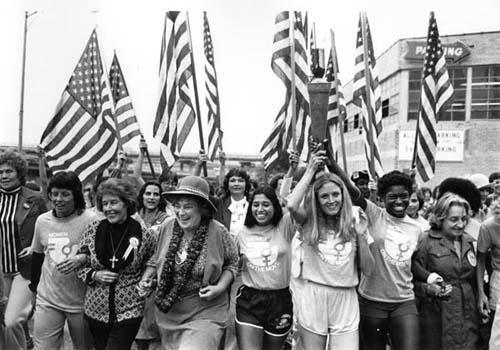 The March into the National Women's Conference (left to right) Billy Jean King, Susan B. Anthony II, Bella Abzug, Sylvia Ortiz, Peggy Kokernot, Michele Cearcy, Betty Friedan