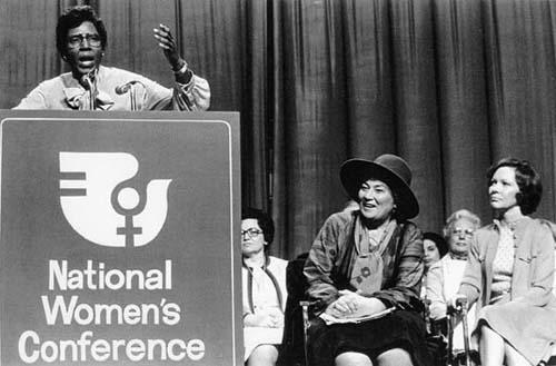 Congresswoman Barbara Jordan Speaking at the National Women's Conference with Bella Abzug and Rosalynn Carter Seated to her Right