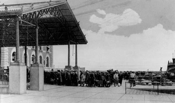 Ellis Island, U.S. Immigration Station; Aliens entering the building for examination