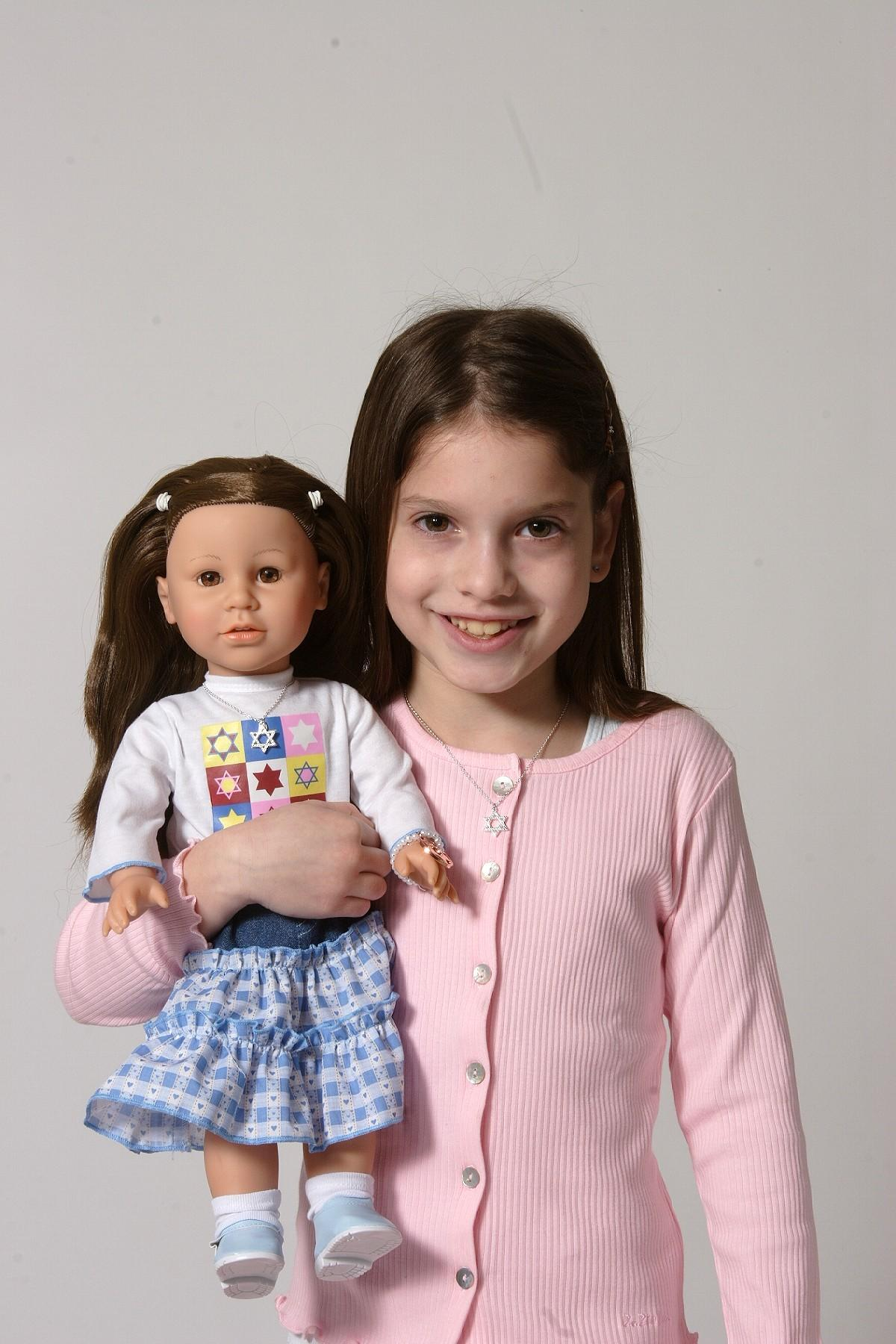 A Girl Holding a Gali Girls Doll