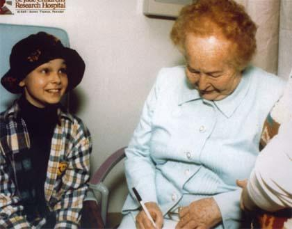 Gertrude Elion with a young leukemia patient