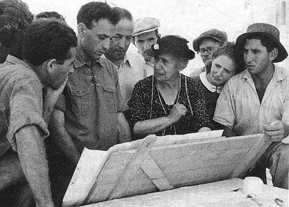 Henrietta Szold going over plans with kibbutz leaders, c. 1940