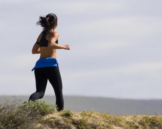 jogging_woman_in_grass.jpg