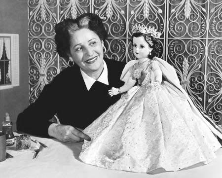 Beatrice Alexander examining the Queen Elizabeth II doll from the Coronation set