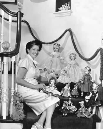 Beatrice Alexander with many of her doll creations
