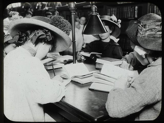 Students writing at the library