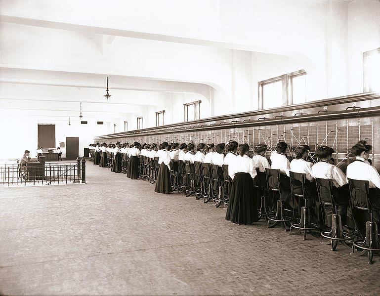 Telephone switchboard operators at work