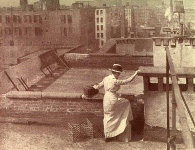 Visiting Nurse Takes Shortcut Over the Roofs of the Tenements