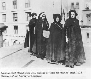 "Lavinia Dock (third from left) holding a ""Votes for Women"" staff"