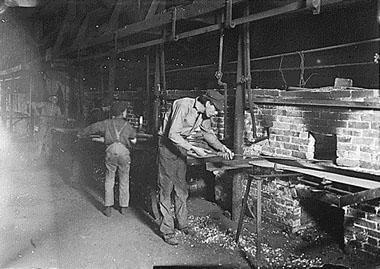 Putting Bottles into the Annealing Oven, an Indianapolis Glass Works, Indianapolis, Indiana, 1908