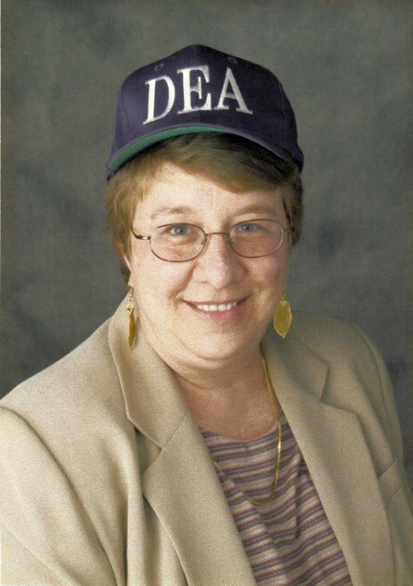 "Donna Arzt in a ""DEA"" hat - still image [media]"