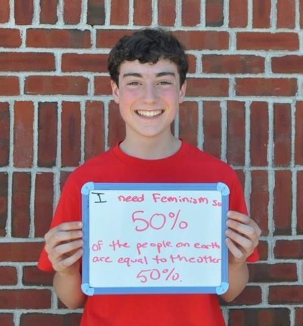 Boy Holding Femininjas Sign