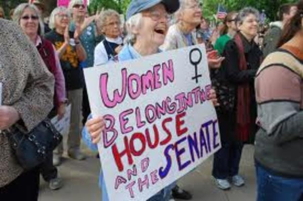 "Woman Holds Sign Reading ""Women Belong in the House and the Senate,"" 2012"