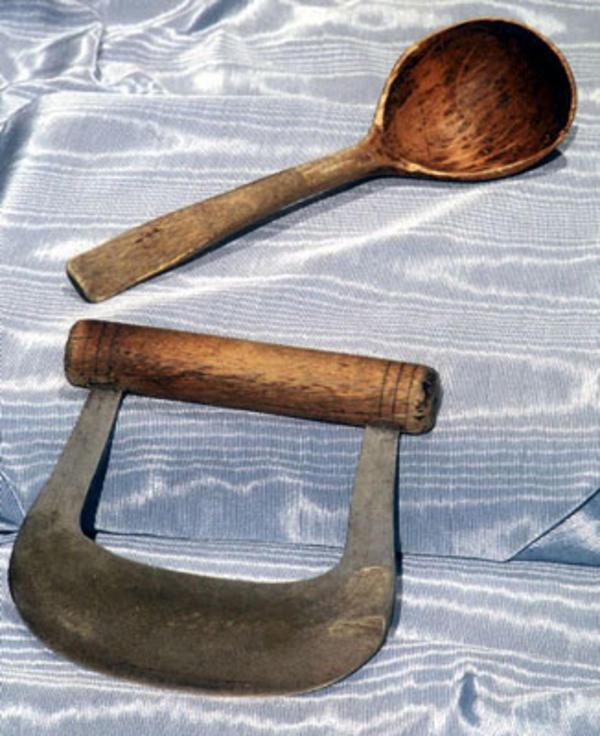 A Chopping Knife and a Wooden Spoon