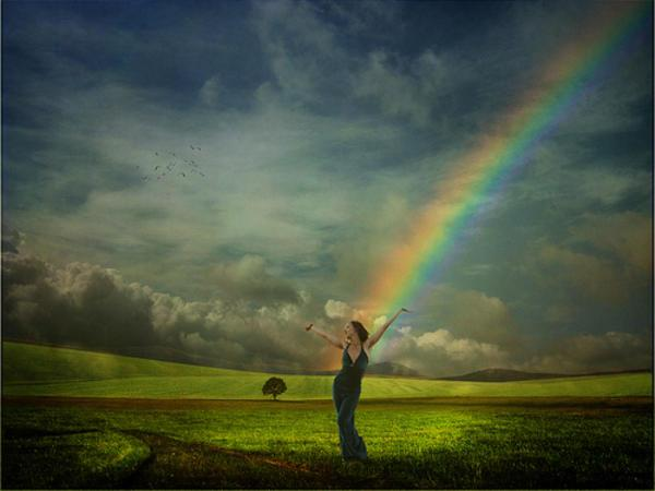 Woman in Field with Rainbow